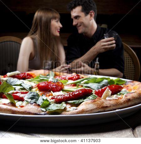 Couple enjoying pizza