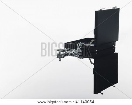 Open briefcase with padlock and chain over white background