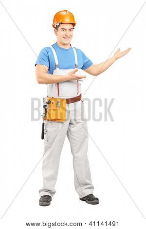 Full length portrait of a manual worker with tool belt and helmet gesturing isolated on white background