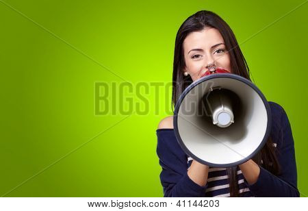 Portrait Of A Female With Megaphone On A Green Background
