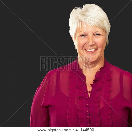 Senior Woman Smiling Isolated On Black Background