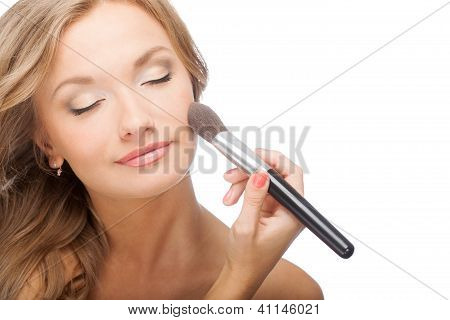 woman applying powder on face