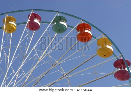 Ferris Wheel Chairs Against Sky