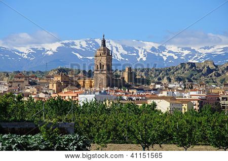 View of town and Sierra Nevada, Guadix, Andalusia.