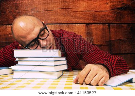 Student Sleeping On Books