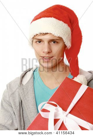 young man in red christmas hat holding gift box , isolated on white background