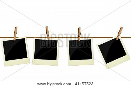 Four Pictures Hanging On Rope