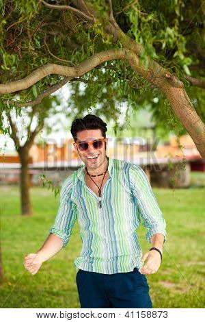 Handsome Man Wearing Sunglasses Having Fun In The Park