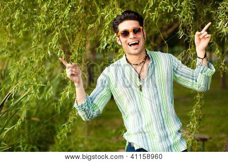 Handsome Man Wearing Sunglasses Singing In The Park