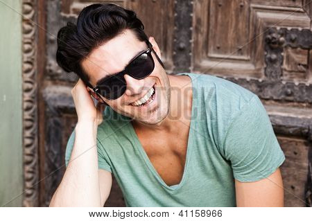Close-up Of Attractive Man Smiling Wearing Sunglasses