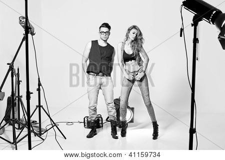Sexy Man And Woman Doing A Fashion Photo Shoot In A Professional Studio - Lights Appear In The Shot