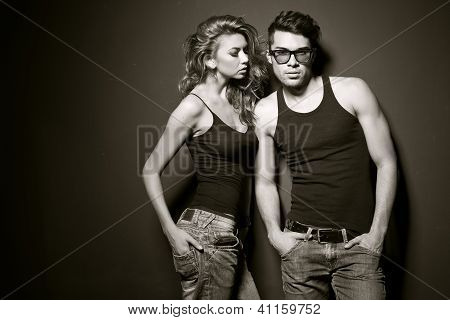 Sexy Man And Woman Doing A Fashion Photo Shoot In A Professional Studio