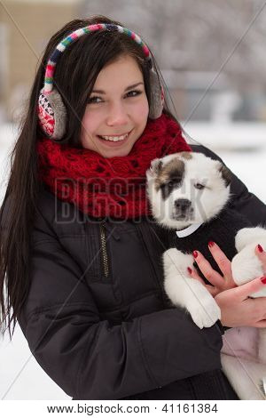 Girl With A Puppy In Winter