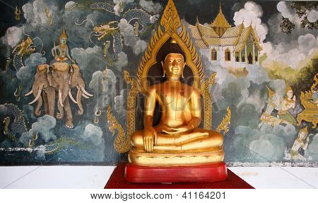 CHIANGMAI - NOVEMBER 30: A gold Buddha statue and wall-art depicting ancient Thai epics adorn the halls of Doi Suthep Temple in Chiang Mai, Thailand on November 30, 2012. This temple founded in 1385.