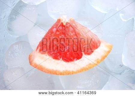 Red grapefruit on ice