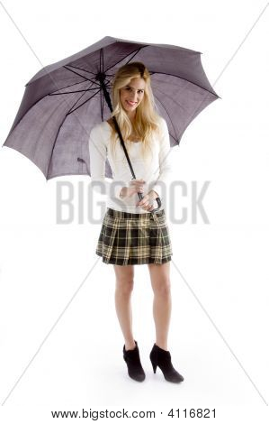 Front View Of Smiling Young Woman Holding An Umbrella