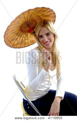 Side View Of Happy Young Woman Holding Umbrella