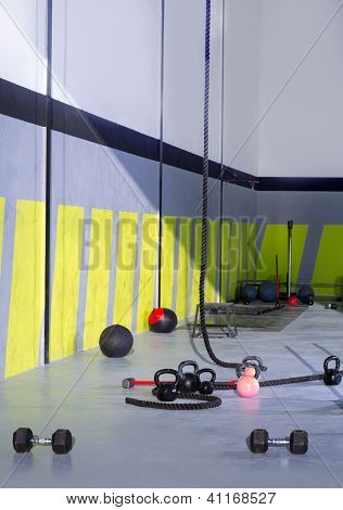 Kettlebells ropes and hammer gym with lifting bars and wall balls