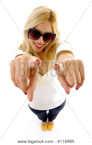 High Angle View Of Smiling Female Model With Pointing Fingers