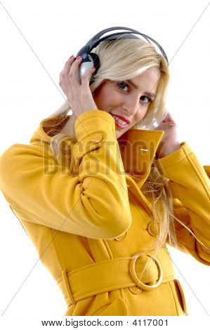 Side View Of Female Holding Headphone