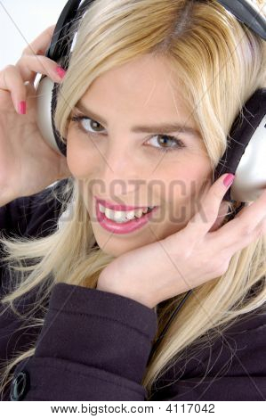 Side View Of Female Listening Music
