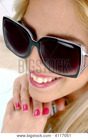 Close Up View Of Smiling Female With Sunglasses