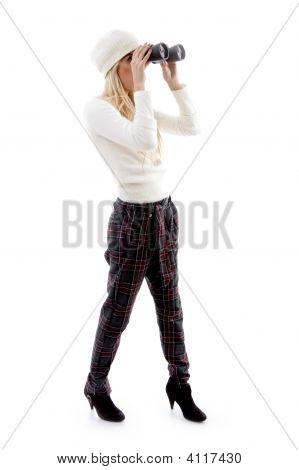 Side Pose Of Woman Viewing Through Binoculars