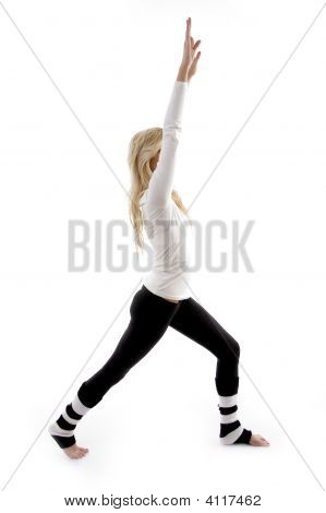 Side View Of Smiling Woman Doing Stretching Exercise
