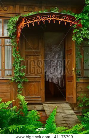 Steps Of The Old Wooden House Decorated With Ivy.