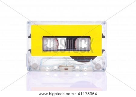 Compact Cassette Isolated On White With Blank Yellow Label