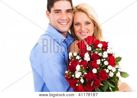 loving young couple with roses on valentine's day