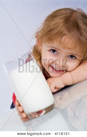 Happy Little Girl With A Glass Of Milk