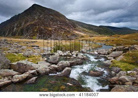 Landscape Over Waterfall Towards Pen-yr-ole-wen Mountain In Snowdonia