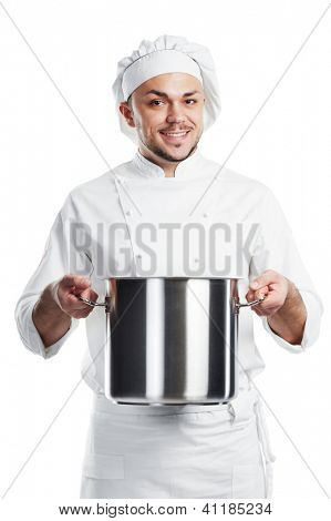 smiling young adult chief with metal pan pot in his hand isolated