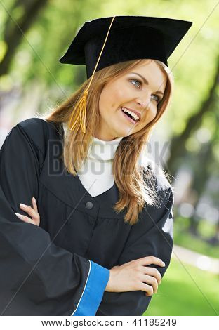 smiling female graduate student girl in the park cheerful and happy