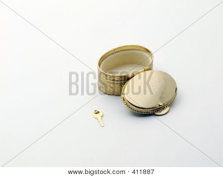Open Golden Case And A Small Key