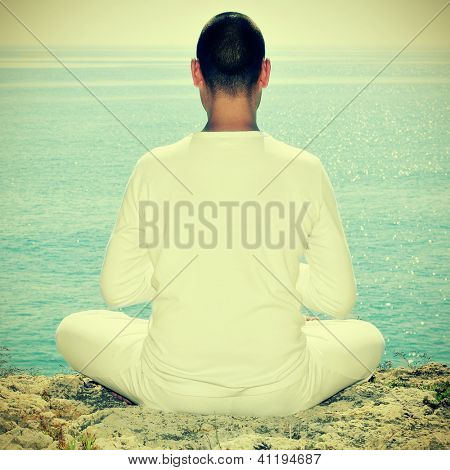 someone meditating in front of the sea