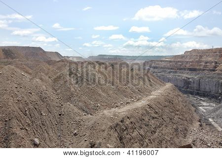 overburden and the visible coal seam at the backdrop in a coal mine