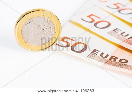 One Euro Coin On 50-euro Banknotes