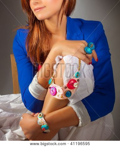 Picture of stylish woman wearing fashionable colorful clothes, pretty girl wearing gorgeous accessories, luxury jewelry, blue jacket and white dress, beautiful necklace and rings, beauty and vogue