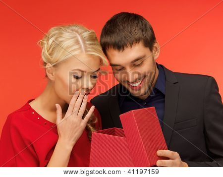 picture of man and woman looking inside the box