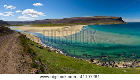 Extremely beautiful bay with mighty golden beaches and turquise sea in the West Fjords, Iceland. Panoramic photo