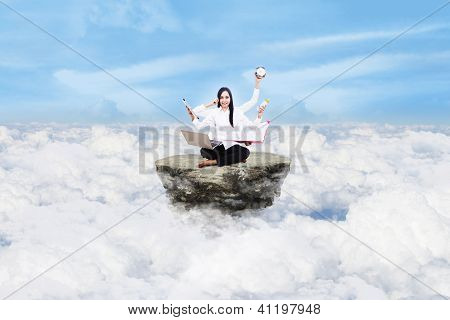 Beautiful Woman Multitasking Above Clouds