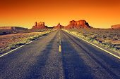 stock photo of wild adventure  - road to Monument Valley at sunset USA - JPG