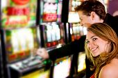 pic of slot-machine  - man and woman having fun at the casino on the slot machines - JPG