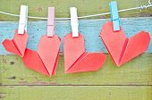 image of wood craft  - paper heart hanging on the clothesline - JPG