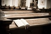 stock photo of pews  - Open Hymnal inside of an austrian Church - JPG