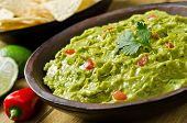 stock photo of cilantro  - A delicious bowl of guacamole with avocado - JPG