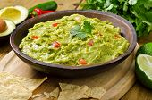 foto of dipping  - A delicious bowl of guacamole with avocado - JPG