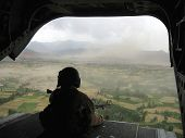stock photo of military helicopter  - tail gunners view from a chinook helicopter  - JPG